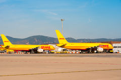 BARCELONA, SPAIN - AUGUST 20, 2016: Yellow cargo planes Boeing 757 from the logistics courier company DHL. Copy space for t Royalty Free Stock Images