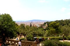 Barcelona, Spain. July 6, 2018: Aerial view of Barcelona from Park Güell. Tourists enjoying sunny summer day in the park stock images