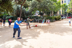 BARCELONA, SPAIN. July 6, 2017: Street artists make soap bubbles in the Plaza de Gaudi for the enjoyment of children and tourists Stock Images