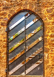 In Barcelona in Spain. Beautiful door of an old building in the famous park Guell at Barcelona in Spain. HDR processed Stock Image