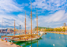 In Barcelona Spain. Big traditional wooden sailboat in port Vell marina in old harbour Barcelona in Spain stock photos