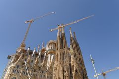 Barcelona, Spain. building of the gaudi Sagrada Familia. Cranes continue the work on the outside of the sagrada familia basilica, barcelona, spain. According to royalty free stock photo