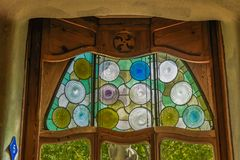 Barcelona, Spain Casa Battlo interior view with organic shapes w. Interior view of one of the Noble Floor stained glass windows at the house designed by Antoni Stock Image