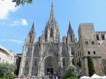 Barcelona, Spain. Cathedral, gothic facade with tourists. royalty free stock photos