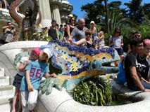 Barcelona, Spain. Children with the Dragon Fountain at Park Guell. stock photography