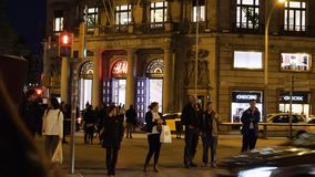 People walking on passeig de Gracia at night Edificio Generali stock video