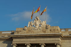 Barcelona, Spain City Hall stone facade coat of arms with flags. Stock Photography