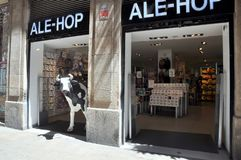 Barcelona, Spain: Local Shop. Barcelona, Spain, with the cow sculpture on display at the local shop royalty free stock images