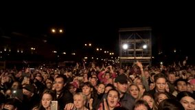 Barcelona, Spain - 09.29.2019: Crowd enjoying concert, happy people smiling, taking photo and video, and cheering stock video footage