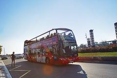 Barcelona, Spain - December 27, 2015: Tourist bus near Port Olimpic marina in the city of Barcelona, Catalonia, Spain Stock Photo