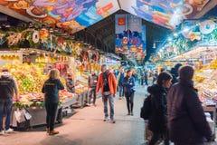 Barcelona, Spain 12.14.2017 editorial of market stalls and people at Mercat de la Boqueria. Barcelona, Spain 12.14.2017 editorial shot of market stalls and Royalty Free Stock Image