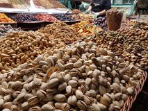 Pistachios, peanuts and other seeds in a market stock image
