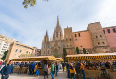 BARCELONA, SPAIN - FEBRUARY 16, 2017: Fair near the Cathedral of the Holy Cross and St. Eulalia. Copy space for text. Royalty Free Stock Image