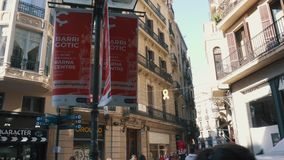 BARCELONA, SPAIN - FEBRUARY 19, 2019: Old streets of Gothic Quarter of Barcelona, Catalonia. Walk through old streets of Barcelona in Gothic Quarter stock video footage