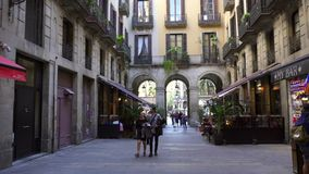 BARCELONA, SPAIN - FEBRUARY 19, 2019: Old streets of Gothic Quarter of Barcelona, Catalonia. Walk through old streets of Barcelona in Gothic Quarter stock footage