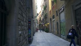 BARCELONA, SPAIN - FEBRUARY 19, 2019: Old streets of Gothic Quarter of Barcelona, Catalonia. Walk through old streets of Barcelona in Gothic Quarter stock video