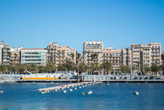 BARCELONA, SPAIN - FEBRUARY 12, 2014: A view to a pier with yachts at Barcelona port. Catalonia, Spain Stock Photo