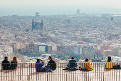BARCELONA, SPAIN - JANUAR 24, 2017: People watching panorama vie. W of Barcelona on a Bunkers del Carmel on weekends royalty free stock image