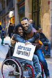 The action of a group of people free hugs on the streets of Barcelona, the inscription in Spanish on posters free hugs. Stock Photos