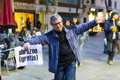 The action of a group of people free hugs on the streets of Barcelona, the inscription in Spanish on posters free hugs. BARCELONA, SPAIN - 14 JANUARY 2018: The Stock Images