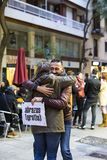 The action of a group of people free hugs on the streets of Barcelona, the inscription in Spanish on posters free hugs. BARCELONA, SPAIN - 14 JANUARY 2018: The Stock Photography