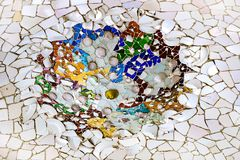 Elements of mosaic fragments Gaudi`s mosaic work in Park Guell In winter in the city of Barcelona. BARCELONA, SPAIN - 13 JANUARY 2018: Elements of mosaic royalty free stock photography