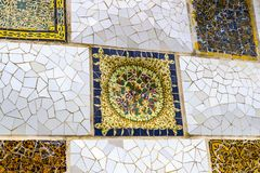 Elements of mosaic fragments Gaudi`s mosaic work in Park Guell In winter in the city of Barcelona. BARCELONA, SPAIN - 13 JANUARY 2018: Elements of mosaic royalty free stock image