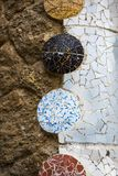 Elements of mosaic fragments Gaudi`s mosaic work in Park Guell In winter in the city of Barcelona. BARCELONA, SPAIN - 13 JANUARY 2018: Elements of mosaic royalty free stock photos