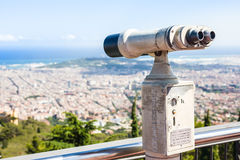 BARCELONA, SPAIN - JULY 13, 2016: Binoculars overlooking Barcelona skyline Royalty Free Stock Image