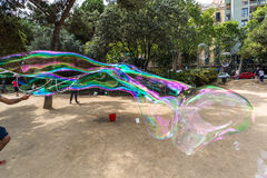 BARCELONA, SPAIN. July 6, 2017: Street artists make soap bubbles in the Plaza de Gaudi for the enjoyment of children and tourists Stock Image