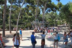 BARCELONA, SPAIN - JULY 8, 2014:  A street entertainer performs. His bubble show for a group of tourists in famous Park Guell on July 8, 2014 in Barcelona Stock Image