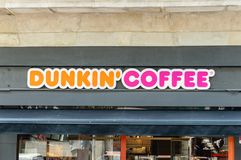 Dunkin` Coffe logo and sign in Barcelona. stock photo