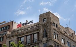 Barcelona, Spain. June 2019: Huawei Technologies Ad sing on a building in Plaza Catalunya. Barcelona, Spain. June 2019: Huawei Technologies Ad sing on top of a royalty free stock photo
