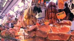 BARCELONA, SPAIN - JUNE 10, 2016: Market stall with expensive spanish ham Jamon at La Boqueria market in Barcelona. BARCELONA, SPAIN - JUNE 10, 2016: Market stock footage