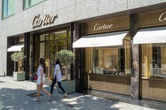 Barcelona, Spain. June 2019: People walking in front of Cartier shop. With in Barcelona`s luxury shopping street of Passeig de Gracia. Consumerism concept royalty free stock image