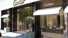 Barcelona, Spain. June 2019: People walking in front of Cartier shop stock footage