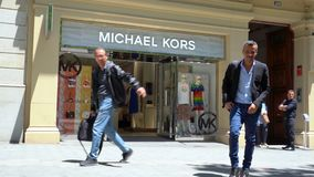 Barcelona, Spain. June 2019: People walking in front of Michael Kors store stock video