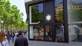Barcelona, Spain. June 2019: People walking in front of Montblanc store stock video footage