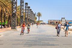 People are walking on the beach of barcelona at the end of the d royalty free stock photography