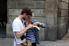BARCELONA SPAIN - JUNE 9:: Tourist looks in a map June 9, 2012 i Stock Image