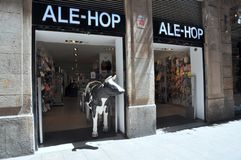 Barcelona, Spain: Local Shop. Barcelona, Spain, with the cow sculpture on display at the local shop royalty free stock photos