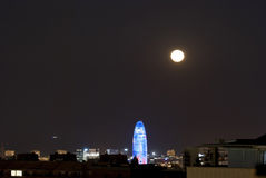Agbar Tower at night with moon, Barcelona Stock Photo