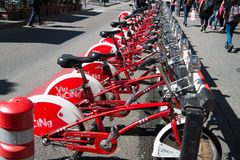 Barcelona, Spain - March 30, 2016: bicycles for rent. Viu Bicing bikes. Public transport of bicycle. City tour and. Travel on bicycle. Summer vacation and royalty free stock photography