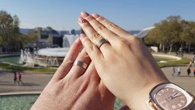 Lovers weeding rings together for eternity stock footage