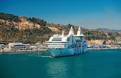 Barcelona, Spain - March 30, 2016: ocean liner GNV Rhapsody Genova in sea harbor at mountains. Cruise destination and. Liner trip. Summer vacation on liner stock images