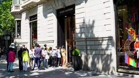 Barcelona, Spain. March 2018: People queuing up in front of Louis Vuitton store stock footage
