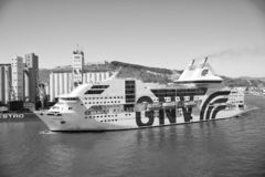 Barcelona, Spain - March 30, 2016: ship or liner GNV Rhapsody Genova in sea harbor on mountain landscape. Cruise ship. Destination and trip. Travelling by sea stock photos