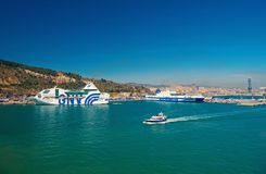 Barcelona, Spain - March 30, 2016: ships GNV and Grimaldi Lines in sea port. Travelling by sea. Summer vacation on ship. Wanderlust and discovery. Water stock photography