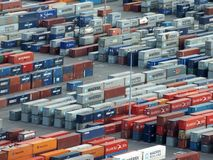 Stacked shipping containers at the cargo port of Barcelona. Barcelona, Spain - March 6, 2016: stacked shipping containers at the cargo port of Barcelona Royalty Free Stock Image