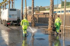 BARCELONA, SPAIN - March 17, 2019: Wet cleaning of street with pressurized water royalty free stock image